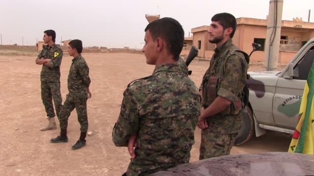 kurdish fighters of the people's protection units ypg in a training camp on october 12, 2014 near the city of al hasakah northern syria. the people's... - people's protection units stock videos & royalty-free footage