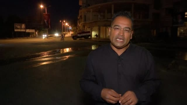 kurdish forces breach the ancient raqqa wall in battle to retake city from islamic state syria homs reporter to camera - クリシュナン・グルマーフィ点の映像素材/bロール