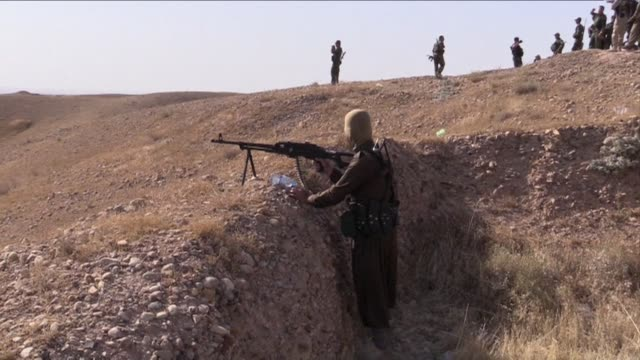 kurdish forces were fighting sunni extremists after the iraqi army left posts in the area - extremism stock videos & royalty-free footage