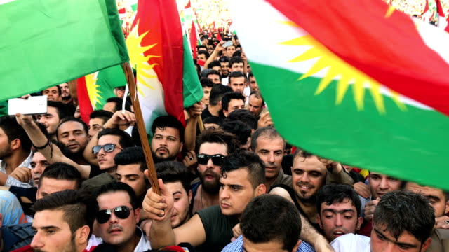 kurdish people show their support for the upcoming referendum for independence of kurdistan at a massive rally held at the erbil stadium on september... - 選挙点の映像素材/bロール
