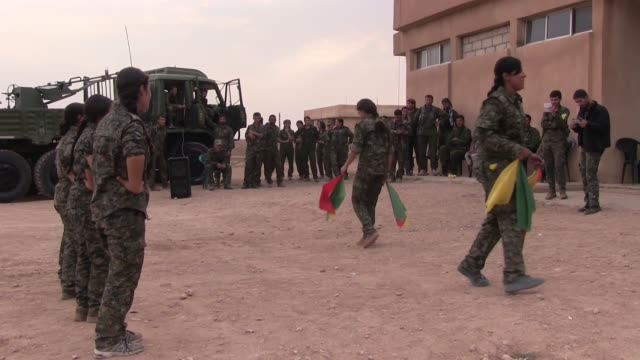 kurdish people's protection unit ypg male and ypj female fighters dancing traditional kurdish dance in a military recruitment ceremony in al hasakah... - eddie gerald stock videos & royalty-free footage
