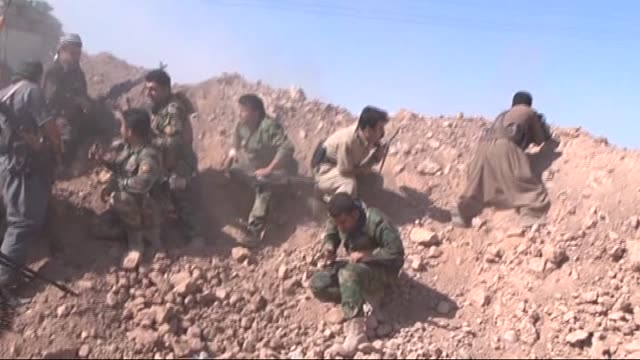 kurdish peshmerga forces carry out a operation on islamic state of iraq and the levant controlled villages of daquq town of kirkuk, iraq on september... - isil konflikt stock-videos und b-roll-filmmaterial