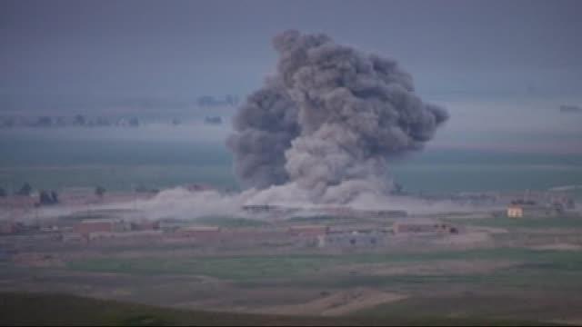 kurdish peshmerga forces launch offensive on daesh in kirkuk and serhat qadir local police chief in kirkuk said that 'coalition warplanes hit the... - 警察署長点の映像素材/bロール
