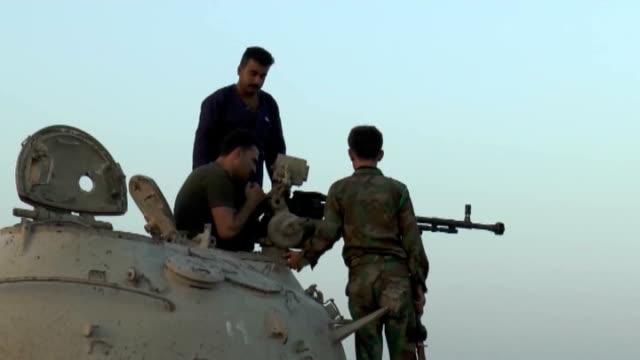 kurdish peshmerga in jalawla of diyala in iraq keep guard against any possible the islamic state of iraq and the levant, isil, attacks, on july 9,... - クルド人点の映像素材/bロール