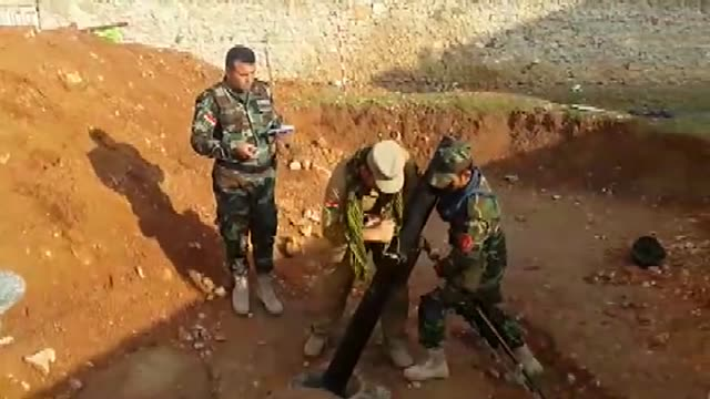 kurdish peshmergas prepare handmade cannons and attack isil forces in aleppo syria on 12 december 2014 - isil konflikt stock-videos und b-roll-filmmaterial