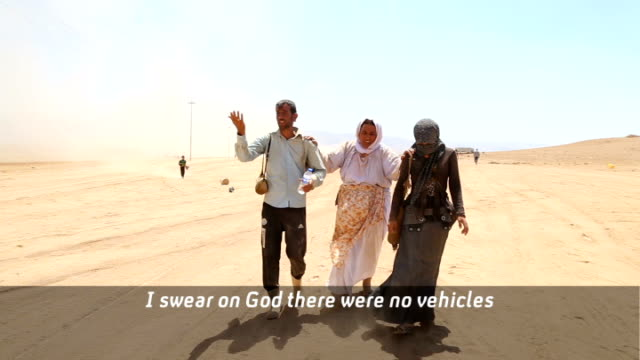 kurdish photojournalist meets yazidi refugees travelling from mount sinjar to syria woman helped along by others [after ten hours walking] people... - photojournalist stock videos & royalty-free footage