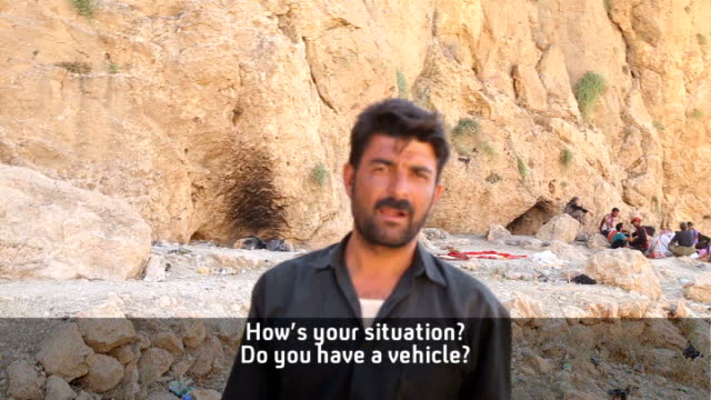 kurdish photojournalist meets yazidi refugees travelling from mount sinjar to syria vox pop - ninawa stock videos & royalty-free footage