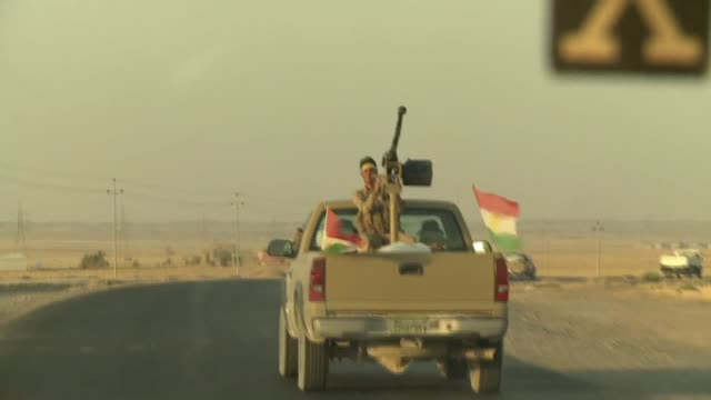 kurdistan fighters seen on the frontline in northern iraq during isil conflict in 2014 - isil conflict stock videos & royalty-free footage