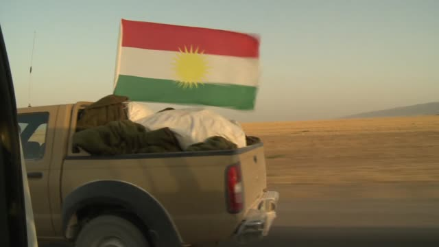 kurdistan flags seen in on the frontline in northern iraq during isil conflict in 2014 - isil conflict stock videos & royalty-free footage
