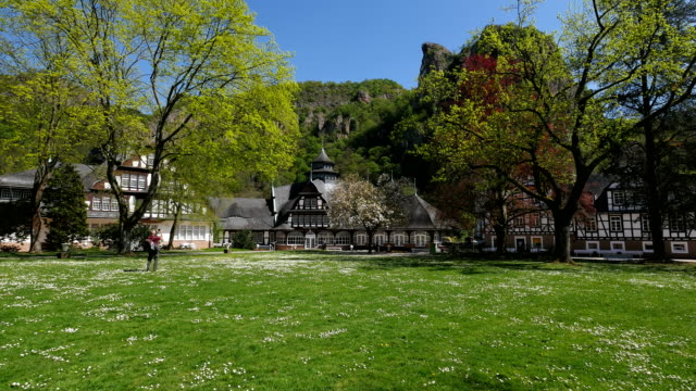 Kurhaus Building with Rheingrafenstein Rock Formation in Bad Muenster am Stein, Nahe Valley, Rhineland-Palatinate, Germany