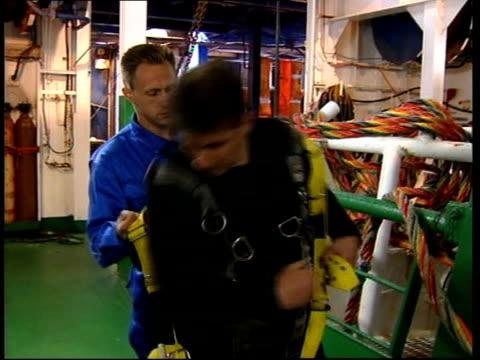 kursk submarine salvage mission; en: joyce ohajah itn scotland: aberdeen: ext gv ship dsnd mayo carrying salvage team preparing to wreck of sunken... - submarine stock videos & royalty-free footage