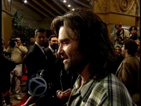 kurt russell talks to reporters about the film and what he'd do in a real hijacking on the red carpet. - kurt russell stock videos & royalty-free footage
