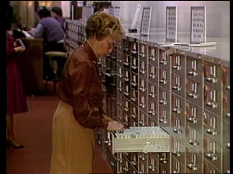 kurt waldheim investigation; tx:4.4.86 itn washington: national archive: side woman at open drawer in line of filing cabinets cms side man closing... - drawer stock videos & royalty-free footage