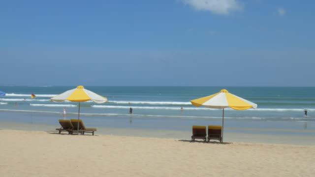 kuta beach,kuta,bali,indonesia - beach chairs stock videos & royalty-free footage