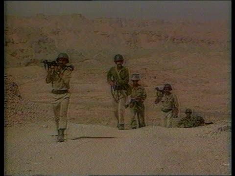 kuwait / iraq oil dispute itn lib f back iraqi troops moving across desert to frontier - kuwait stock videos and b-roll footage