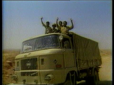 kuwait / iraq oil dispute itn lib iraqi troops along on truck - kuwait stock videos and b-roll footage