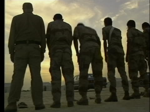 kuwaiti soldiers pray in the desert. - (war or terrorism or election or government or illness or news event or speech or politics or politician or conflict or military or extreme weather or business or economy) and not usa stock videos & royalty-free footage