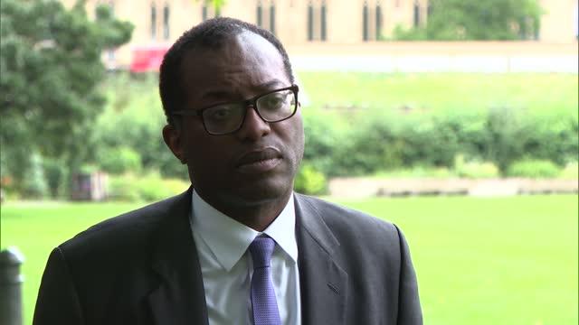 kwasi kwarteng interview; england: london: westminster: ext / raining kwasi kwarteng mp interview sot. re. targets -need to ramp up -no take up in... - 10 11 years stock videos & royalty-free footage