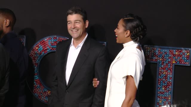 Kyle Chandler and Kylie Bunbury at the 'Game Night' World Premiere at TCL Chinese Theatre on February 21 2018 in Hollywood California