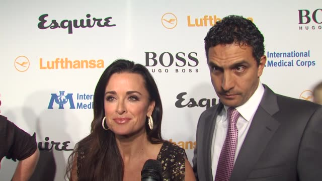 kyle richards, mauricio umansky on tonight's event, on what they're looking forward to seeing in the esquire house, on what every bachelor pad should... - 独身男性点の映像素材/bロール