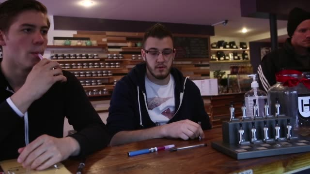 ms kyle stamm and steven fornoff of new york vape or smoke an electronic cigarette at henley vaporium on april 29 2014 in new york city a new law... - stamm stock videos and b-roll footage