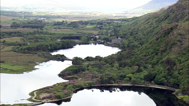 kylemore abbey  - aerial view - connaught, galway, ireland - republic of ireland stock videos & royalty-free footage