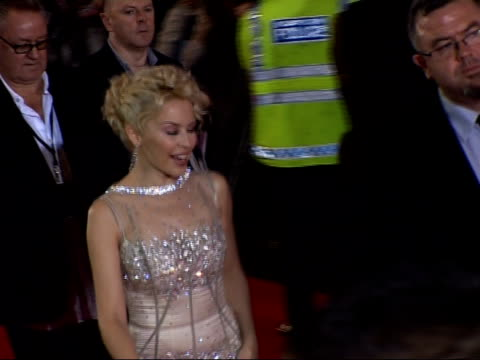 Kylie Minogue attends premiere of 'White Diamond' ENGLAND London EXT Singer Kylie Minogue along red carpet Kylie signing autographs SIDE Kylie...