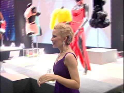 kylie minogue clothes exhibition at the victoria & albert museum: kylie arrival and interviews / kylie touring exhibition; kylie away from podium to... - kylie minogue the exhibition stock videos & royalty-free footage