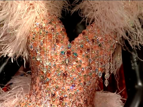 kylie minogue clothes exhibition at the victoria & albert museum; england: london: sparkly pink showgirl outfit on mannequin in kylie exhibition... - kylie minogue the exhibition stock videos & royalty-free footage