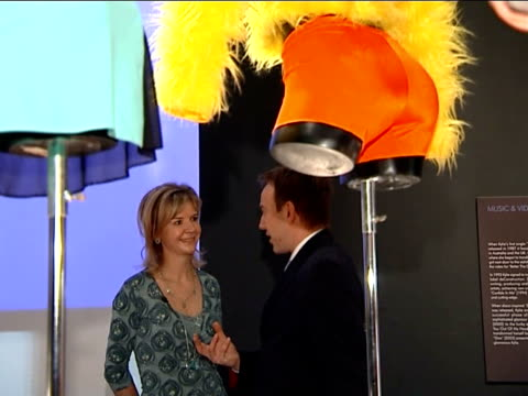 kylie minogue clothes exhibition at the victoria & albert museum; broakes interview with reporter in shot sot - kylie minogue the exhibition stock videos & royalty-free footage