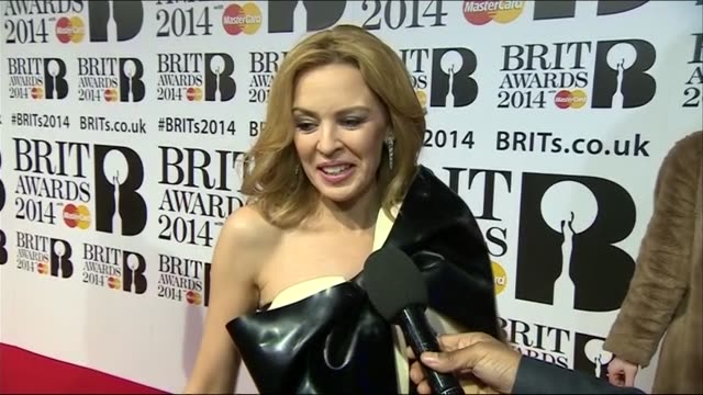 kylie minogue gives advice to brit nominated acts during red carpet interview at the brit awards 2014 - 2014 stock videos & royalty-free footage