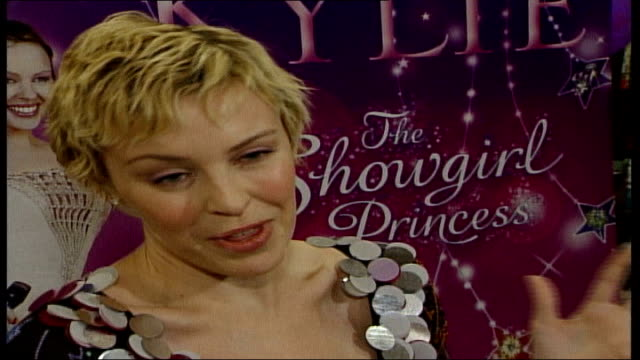 kylie minogue writes children's book * * * intermittent flash photography * * * kylie minogue wearing dark flowers and sequins along to photocall... - girls flashing camera stock videos and b-roll footage