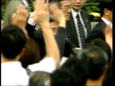 britain and japan discussions ext ms koizumi getting off bus and waving to wellwishers as along pan lms politician speaking in square against nissan... - beer cap stock videos & royalty-free footage