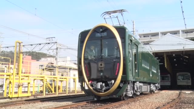 A train operator in Kyoto on Wednesday unveiled a new train carriage featuring a huge gold oval design on the front Eizan Electric Railway Co showed...