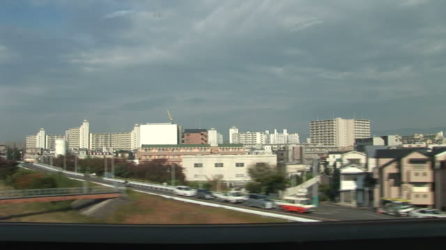 kyoto, japanview from a moving train in kyoto japan - 住宅購入点の映像素材/bロール