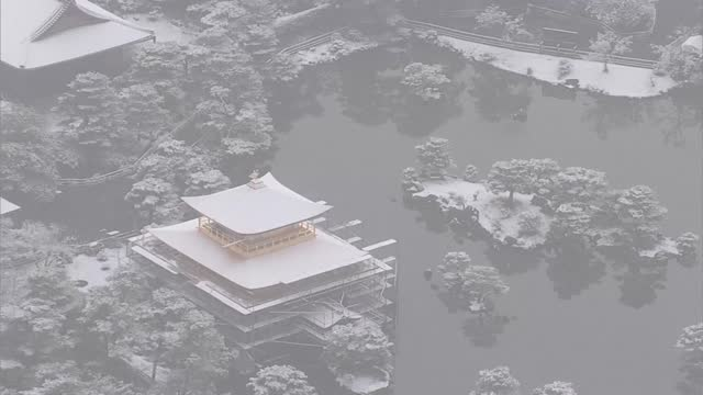 kyoto's famed sites kiyomizudera temple, heianjingu shrine and kinkakuji temple are seen from the air on dec. 17 after a storm brushed the city white... - shrine stock videos & royalty-free footage