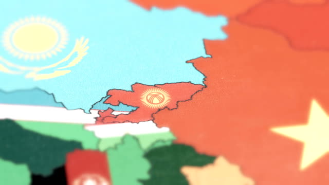 Kyrgyzstan with National Flag on World Map