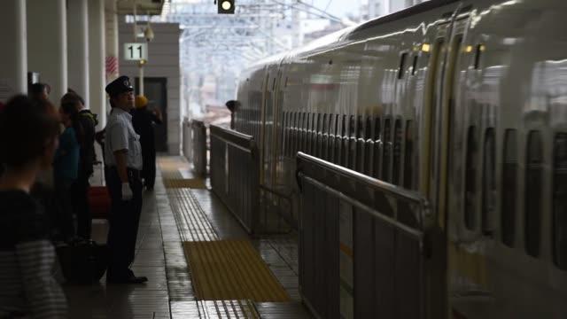 kyushu railway co. 800 series shinksnsen bullet train arrives at hakata station in fukuoka city, fukuoka prefecture, japan, on tuesday, oct 11, 2016 - kyushu railway stock videos & royalty-free footage