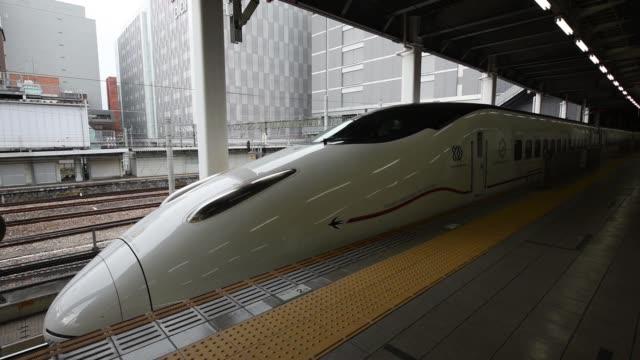 kyushu railway co. 800 series shinksnsen bullet train stops at hakata station in fukuoka city, fukuoka prefecture, japan, on tuesday, oct 11, 2016 - kyushu railway stock videos & royalty-free footage