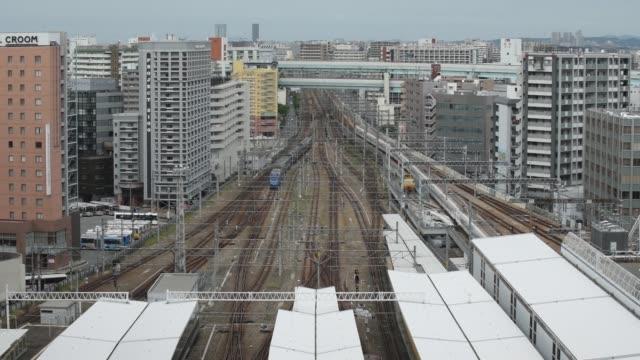 kyushu railway co trains are seen from the hakata station building in fukuoka city fukuoka prefecture japan on tuesday oct 11 2016 - kyushu railway stock videos & royalty-free footage