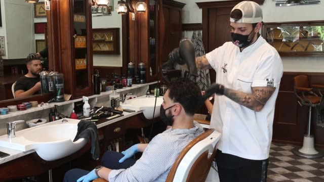 la barbieria barber shop and hairdresser cut hair on the first day as the lockdown restrictions ease on may 18 2020 in milan italy restaurants bars... - hairdresser stock videos & royalty-free footage