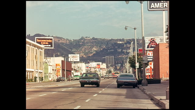 la brea ave traffic in 1974 looking north towards hollywood - hollywood california stock videos & royalty-free footage