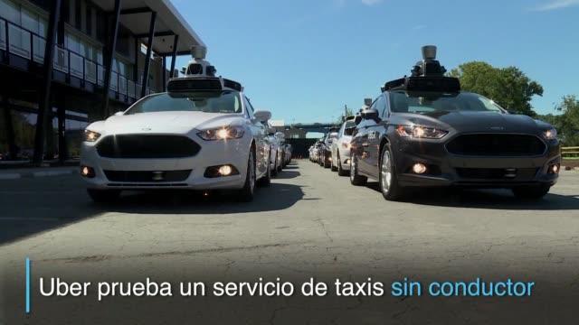 la empresa uber lanzo el miercoles un servicio de taxis sin conductor en un experimento que podria revolucionar el transporte - transporte bildbanksvideor och videomaterial från bakom kulisserna