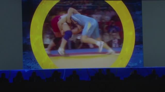 la lucha recupero este domingo su condicion de deporte olimpico, al imponerse sobre el beisbol/softbol y el squash, en la 125 sesioon del comite... - puente stock videos & royalty-free footage