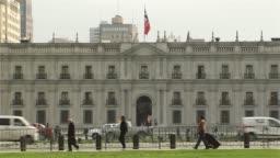 La Moneda Palace And Chile Flag, In Santiago De Chile.