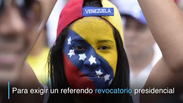 La oposicion venezolana salio masivamente a las calles el jueves para presionar por un referendo revocatorio al presidente Nicolas Maduro quien...