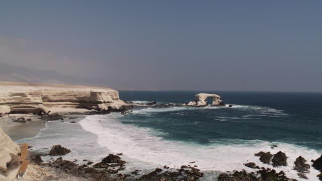 la portada, a natural arch on the coast of chile near antofagasta - antofagasta region stock videos and b-roll footage