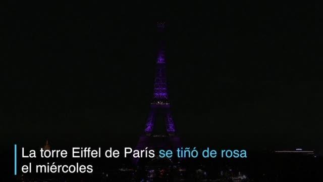 vídeos y material grabado en eventos de stock de la torre eiffel de paris se ilumino de color rosa el miercoles como parte de una campana de lucha contra el cancer de mama - una rosa