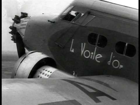 la voile d'or on side of parked commercial airplane junkers jumo 4 commercial aircraft taxiing large twin engine bi-plane taking off. - プロペラ機点の映像素材/bロール