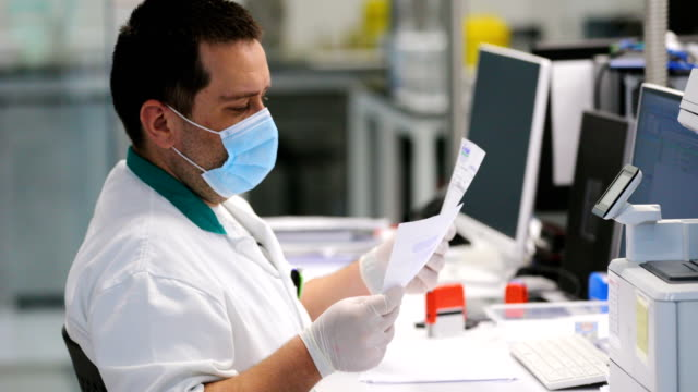 lab technician at work - data stock videos & royalty-free footage